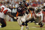 (Tampa, Fla., on Sun. Oct. 3, 2004)   Denver Broncos runningback Quentin Griffin, #22, splits ...