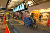 Santiago Torres (cq) digs up carpet in the main terminal at DIA, Tuesday evening, July 8, 2008,...