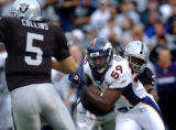 (DENVER, Co., SHOT 10/17/2004) The Denver Broncos' Donnie Spragan (#59, LB) tries to chase down...