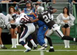 (DENVER, Co., SHOT 10/17/2004) The Denver Broncos' Rod Smith (#80, WR) is chased down by the...