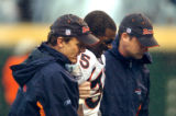 (DENVER, Co., SHOT 10/17/2004) The Denver Broncos' Lenny Walls (#35, CB) is escorted off the field...
