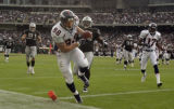 (OAKLAND, CA., OCTOBER 17, 2004)  Denver Broncos' #88, Jeb Putzier, ceneter, crosses the goal line...