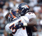 (DENVER, Co., SHOT 10/17/2004) The Denver Broncos' Dwayne Carswell (#89, TE) celebrates a 10 yard...