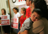 Martha Carranza (cq) holds her grandson Estevan Contreras (cq), 2, at a press conference on a...