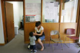 Karla Carranza, 14, plays with her nephew Estevan Contreras (cq), 2, at a press conference on a...