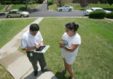 John Aguilar, of Denver Water, gives a warning to Yolanda Vargas for watering between 10 am and 6...