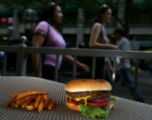 A portrait of French Fries and a Hamburgeron a table, Thursday afternoon, July 10, 2008, at...
