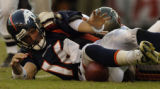 (Tampa, Fla., on Sun. Oct. 3, 2004)   Denver Broncos Jake Plummer, left, loses the ball, but...