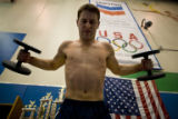 Joe Hagerty (cq), a gymnast, lifts weights  during a workout at the United States Olympic Training...