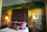 A country scene painted on the wall in a bedroom in Bella Vista, one of the houses in the Parade...