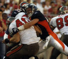 (Tampa, Fla., on Sun. Oct. 3, 2004)   Denver Broncos safety John Lynch, #47, stops  Tampa Bay...