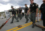 1164  Summit County Sheriif John Minor and other local law enforcement officers push open the east...