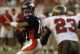 (Tampa, Fla., on Sun. Oct. 3, 2004)   Denver Broncos quarterback looks to pass as Tampa Bay...