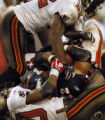 (Tampa, Fla., on Sun. Oct. 3, 2004)   Denver Broncos running back Quentin Griffin, #22, is brought...