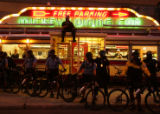 Riot Police stand guard in front of Mickey's Diner in downtown St. Paul, Minn., on Tuesday,...