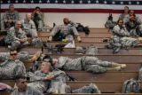 Soldiers of the 2nd Brigade Combat Team, 4th Infantry Division waited during processing before...