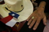 The hand of Texas Representative and delegate Leo Berman rests next to another delegate's cowboy...