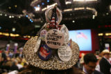 Kendal Unruh, a delegate from Castle Rock,  wears her hat festooned with handmade buttons early in...