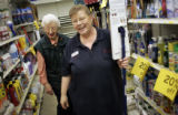 Jeanine Pearson (cq), right, the head cashier at General Hardware,  helps longtime customer Evelyn...