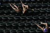 (top left) Lynne Dettmann (cq) and her daughter Maranda Dettmann (cq) soak in the sun at Coors...
