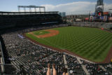 (from left) Jackie Lombardi (cq) and Julie Mueller (cq) enjoy a day in the sun at Coors Field as...