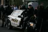Police officers in full riot gear take a break in downtown St. Paul on the final day of the...