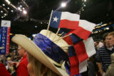 Sandy Golden of Texas walks by with flags on her hat on the final day of the Republican National...