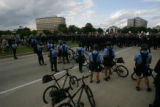 Police in riot gear and on bicycle assemble at the State Capitol in St. Paul on the final day of...