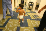 Gabriel Basquez, 19 months,  walks in the hallway at Children's Hospital in Aurora, where he's...