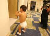 Gabriel Basquez, 19 months,  peaks in the room where he'll get an echocardiogram at Children's...