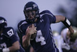 #4 Danny Spond (cq) runs for the first touchdown of the game as the Columbine Rebels football team...