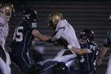 #85 James Cunninhgam (cq) and #75 Cole Tomsick (cq) rip down #5 Zach Jackson (cq) as the Columbine...