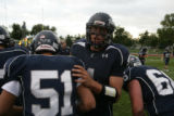#4 Danny Spond (cq) warms up on the field before the Columbine Rebels football team beats the...