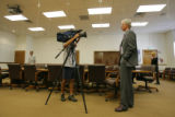 DM4541  Jeff Peckman is interviewed by a Channel 4 photojournalist after meeting with Assistant...