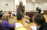DM4548  Jeff Peckman shakes hands with Assistant City Attorney David Broadwell and City Council...