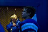 Willy Smagh (cq) listens to the national anthem before the Broomfield football game. #47 Jake...