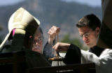 (PG5129) Altar server Sean McDevitt (right) prepares the incense during attend an outdoor Youth...