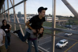 Corey Roseberry, 19 (cq) jumps on his sister Hayley's (cq) shoulders after exiting a light rail at...