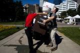 Brett Bailey and Mike Lay (cq) of Ferguson Enterprises lift a toilet into the back of their truck...