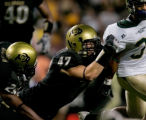 #47 Shaun Mohler (cq) of Colorado tackles #31 Dion Morton (cq) CSU during the Colorado versus...