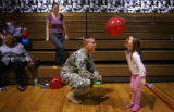 (PG8407) Pfc. Andrew Hufferd (cq) watches his niece Leah Bondurant, 7, play with a balloon after a...