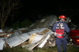 Task Force members of Colorado Task Force 1 identify structures that are severely damaged, search...