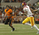 ORSS101 - Oregon State tailback Jacquizz Rodgers, left, looks to avoid Southern California's Vidal...