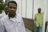 Ahmed Kalif (left) joined scores of Somali workers In Greeley for mid day prayers at the Greeley...