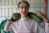 0788 Jean Wann, 82, carries a prize zucchini out to her car after winning it in a raffle at the...