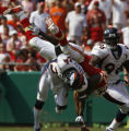 JOE0823 Denver Broncos Champ Bailey (24) upends Kansas City Chiefs Larry Johnson to cause a fumble...
