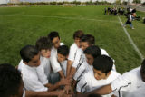 (Aurora, Colo., October 4, 2004) Members of the Aurora Central High School soccer team gather...