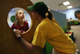 MJM526   Joscelyn Martin (cq), 6, left, makes a face to her mother, Lori Martin (cq) Friday...