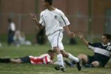 (Aurora, Colo., October 4, 2004) Aurora Central High School midfielder Lazaro Torres celbrates...