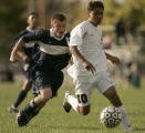 (Aurora, Colo., October 4, 2004) Aurora Central High School midfielder Mario Frausto, right,...